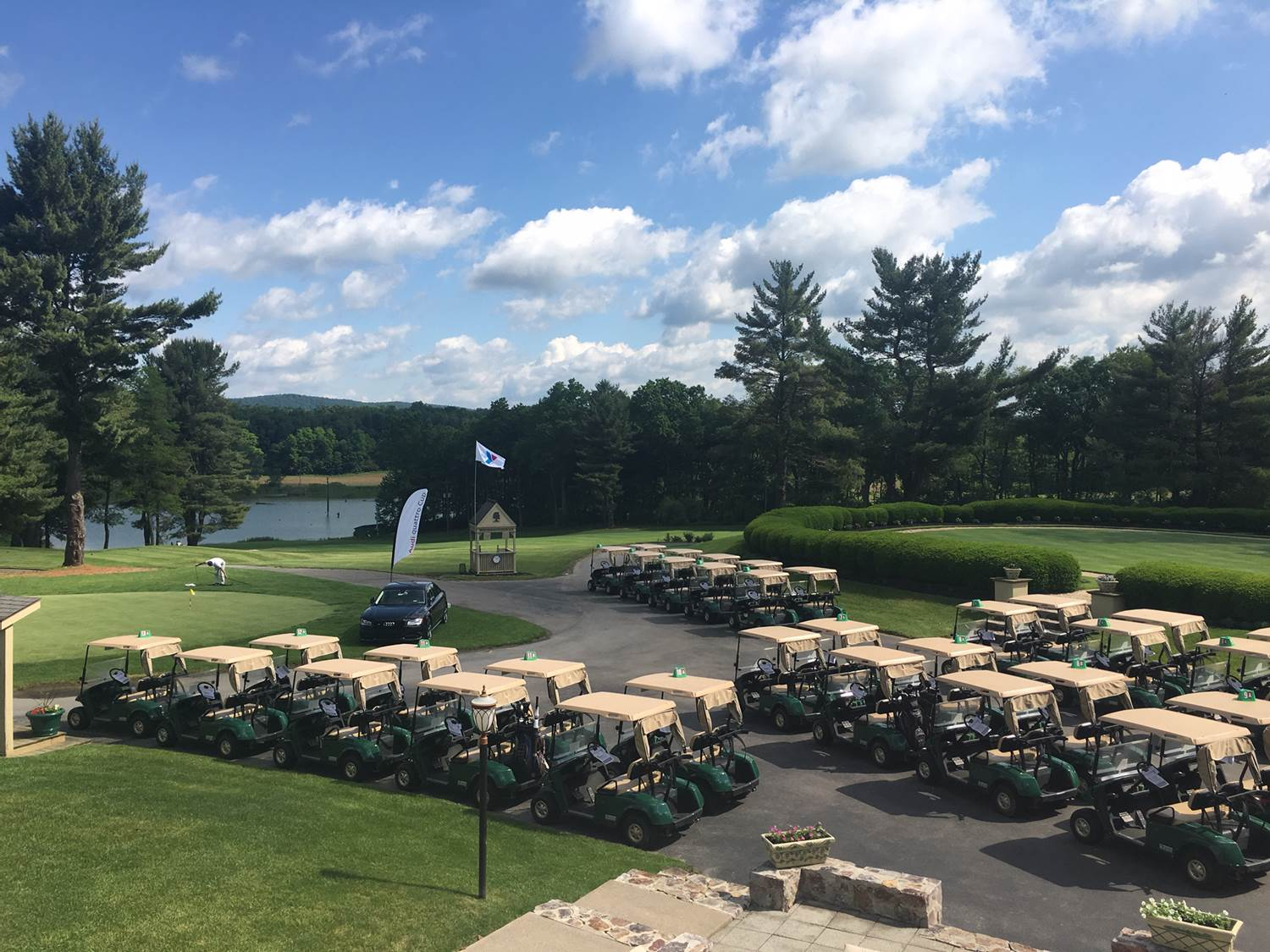 A fleet of golf carts lined up for an event at Toftrees